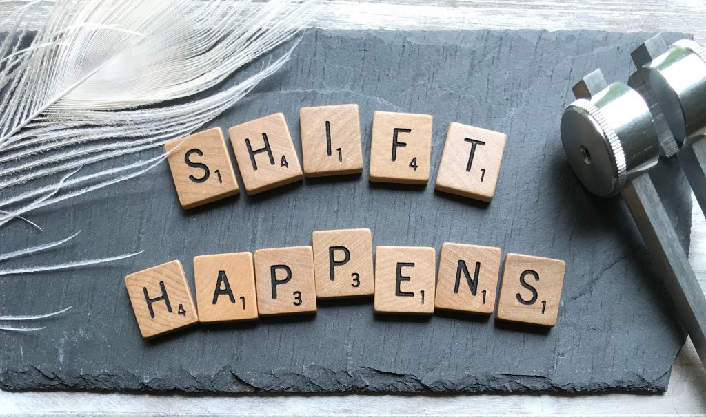 "The words ""shift happens"" are spelled out in Scrabble pieces. This implies a change in markets requires a change in marketing."